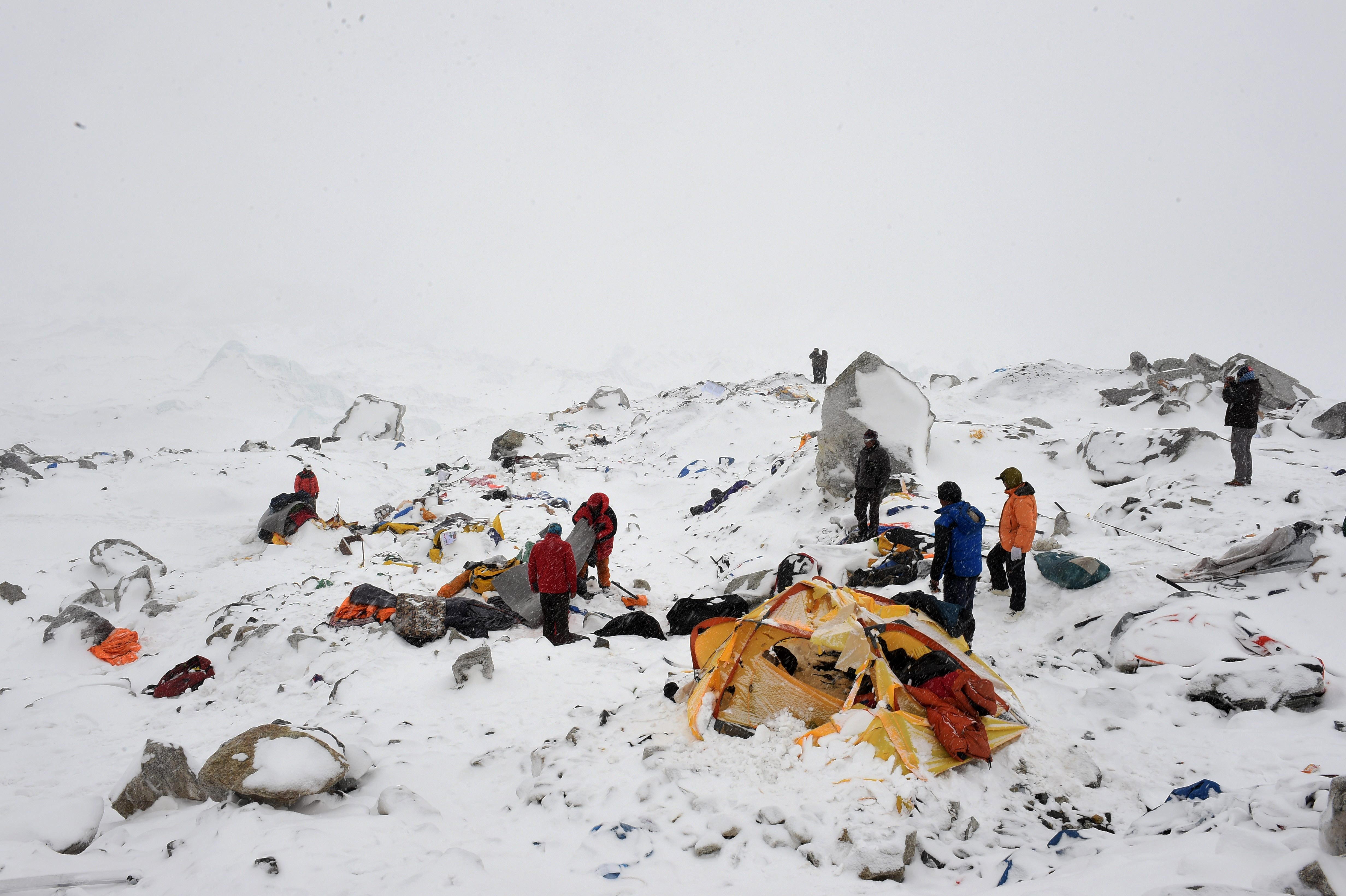 Rescuers search for survivors after an avalanche at the Mount Everest base camp. Filmmaker Tom Taplin and two other Americans were among at least 17 killed there following an earthquake in Nepal. (Getty)