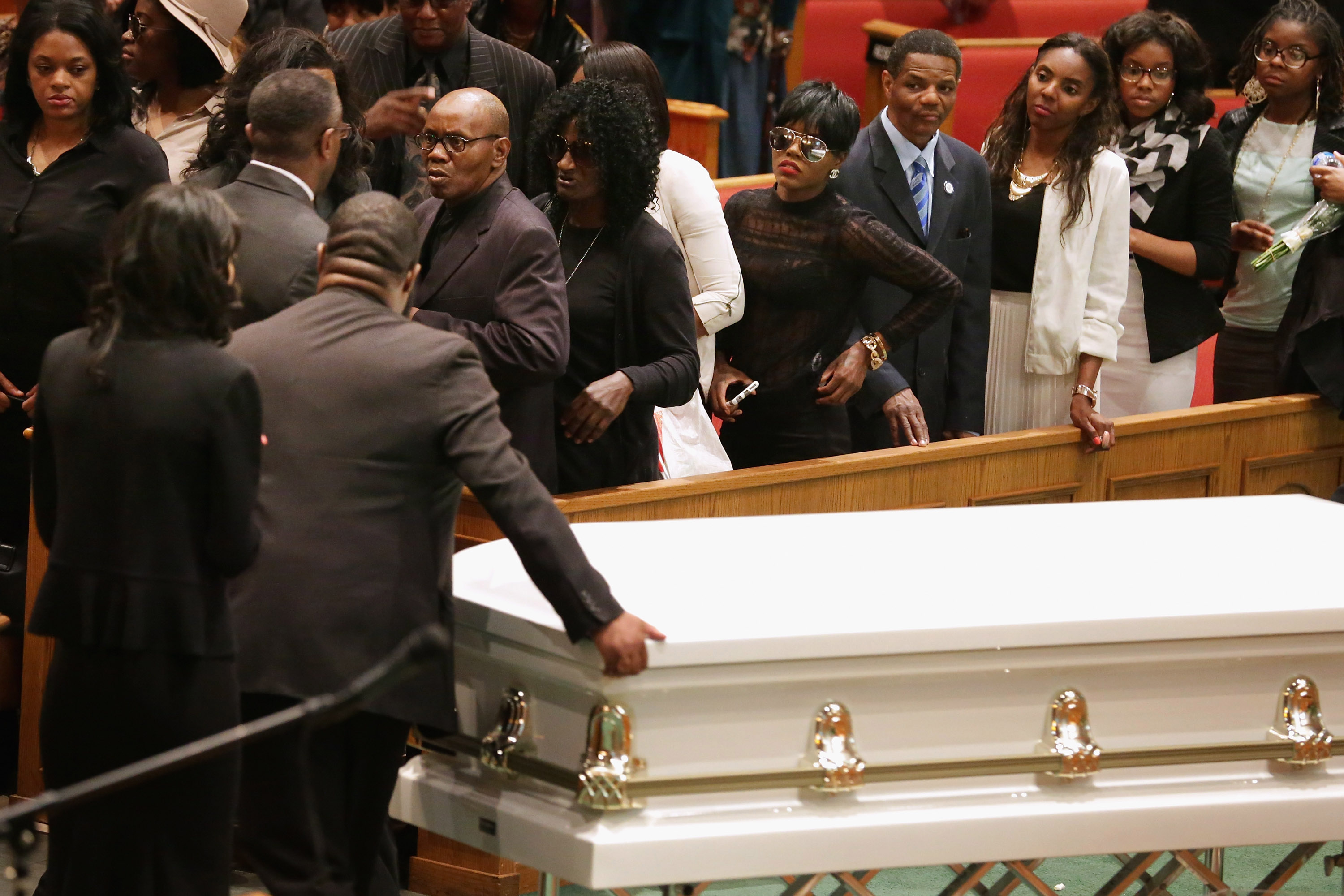 Fredericka Gray, in sunglasses, at her brother's funeral. (Getty)