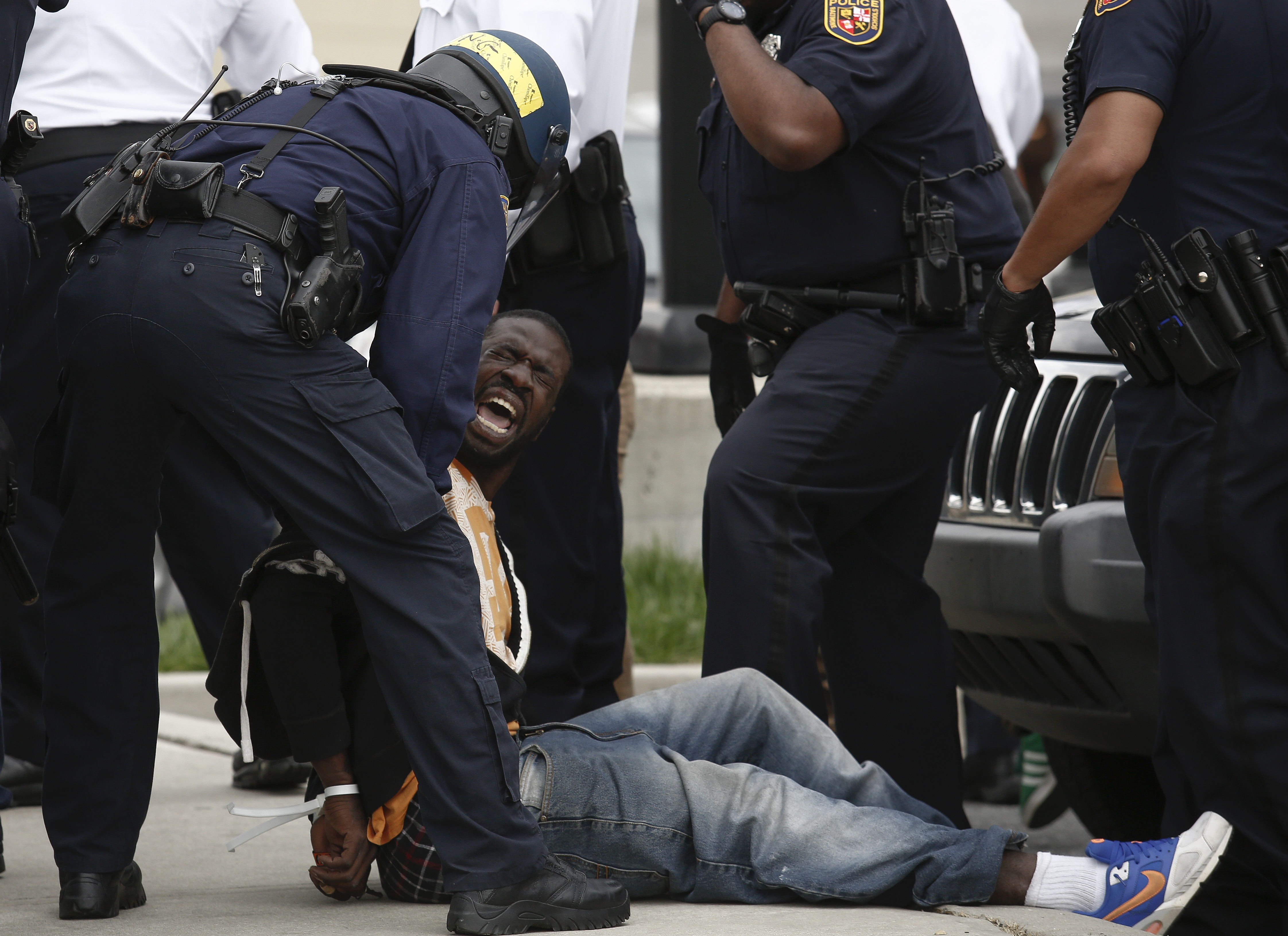 Police arrest a man at protests in Baltimore. (Getty)