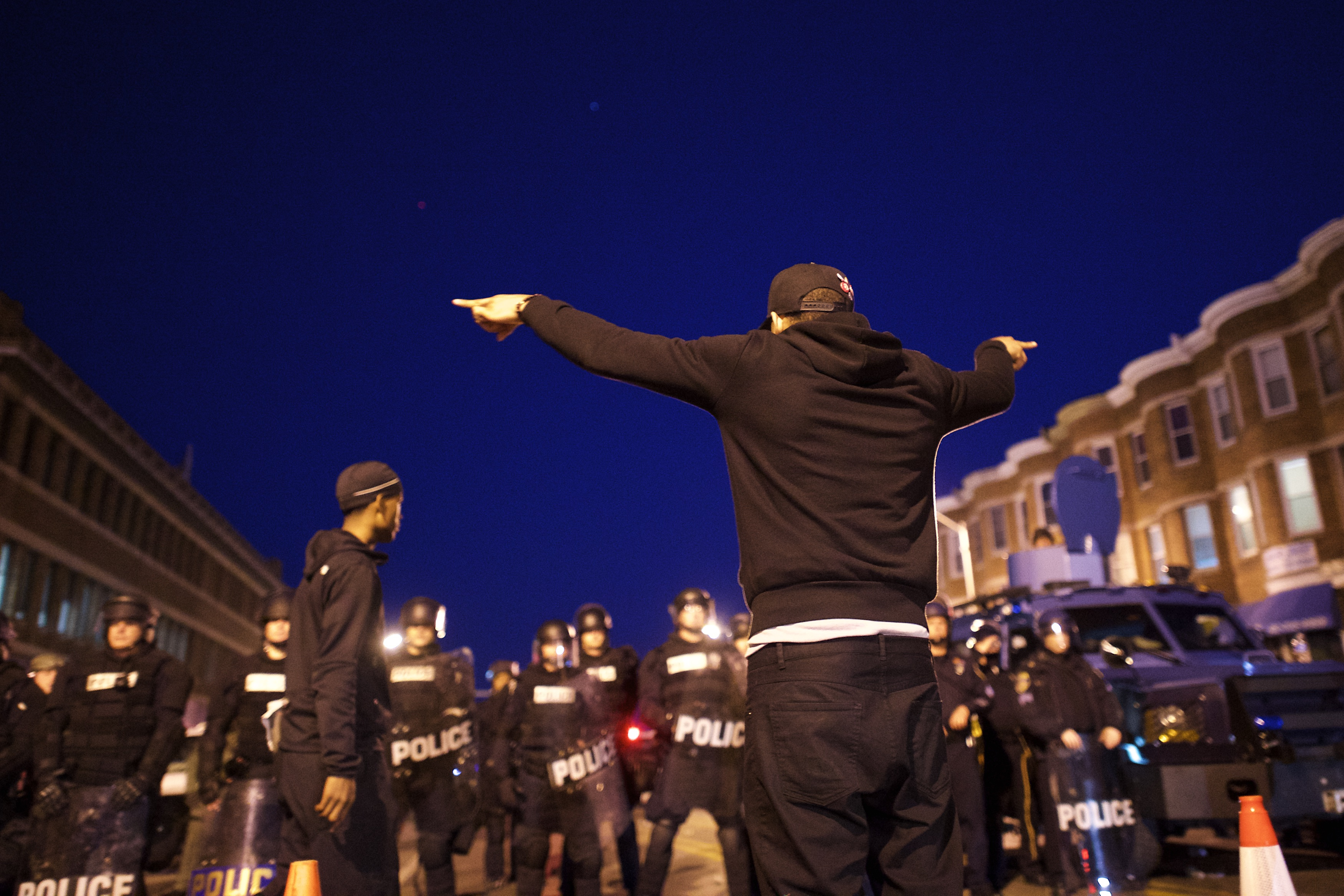 A protester faces off with police the night after citywide riots over the death of Freddie Gray on April 28, 2015 in Baltimore, Maryland.  (Getty)