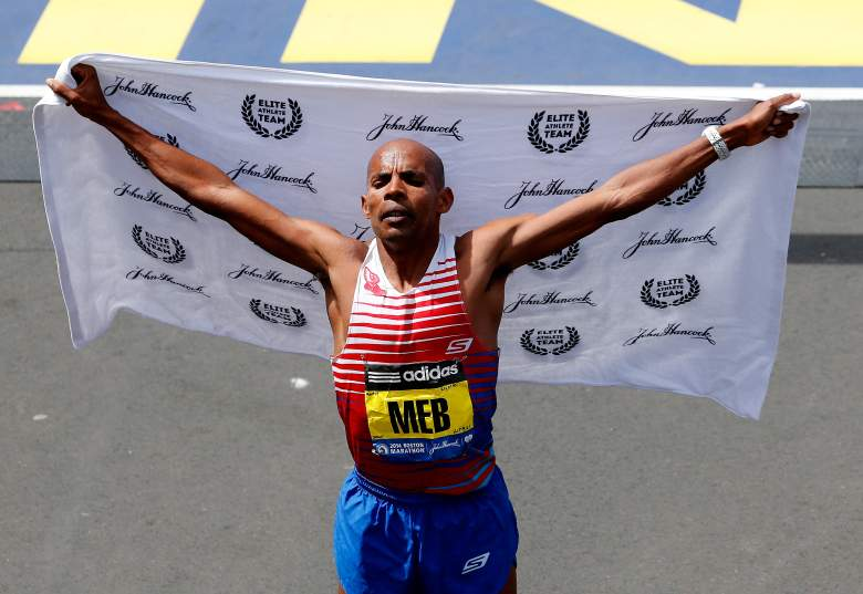 Meb Keflezighi celebrates after winning the 2014 Boston Marathon. (Getty)