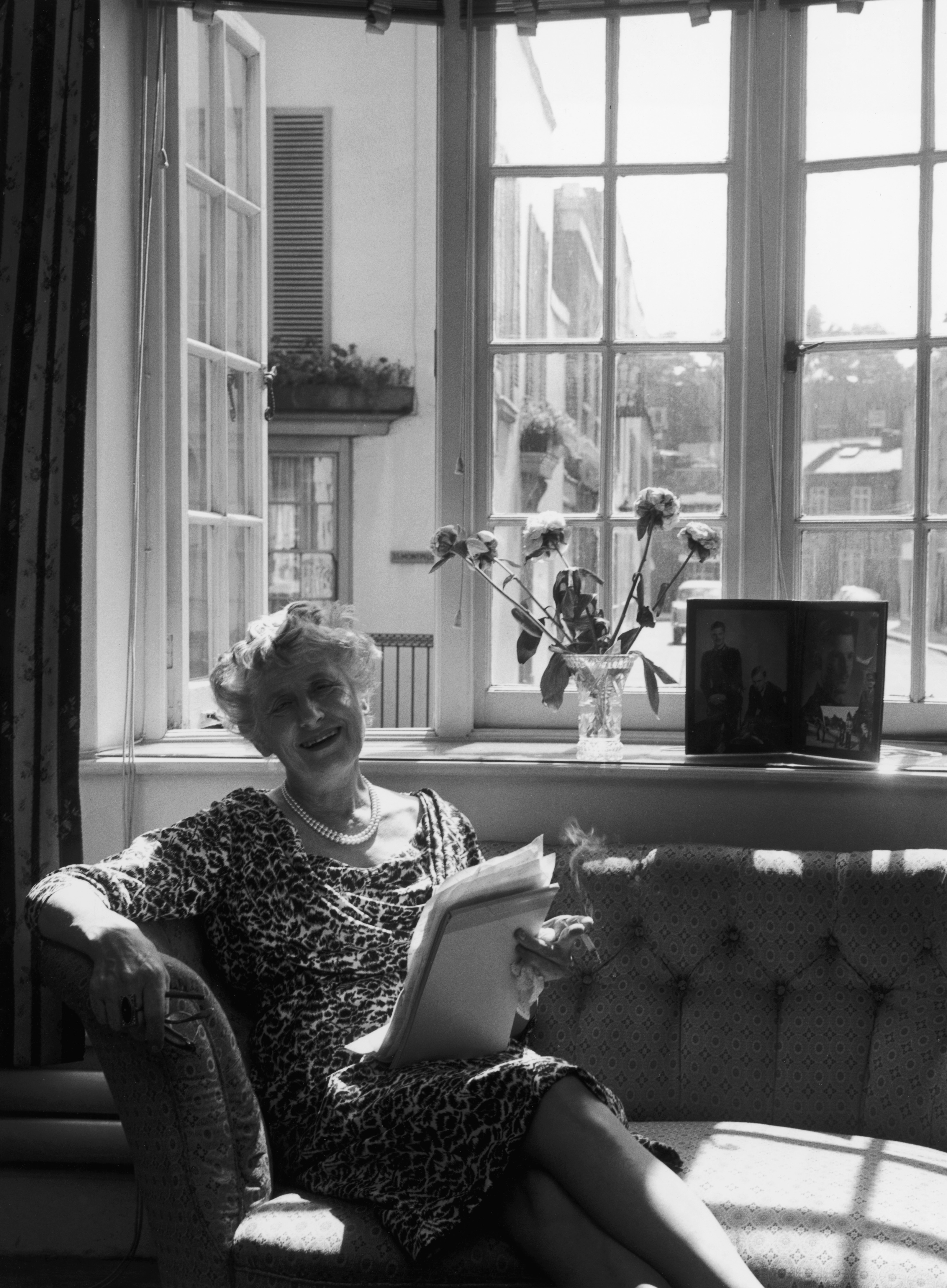 New Zealand-born crime writer and theatre director Ngaio Marsh (1895 - 1982) rereads the notes for her latest book in the sitting room of her Kensington home, 1966. (Getty)