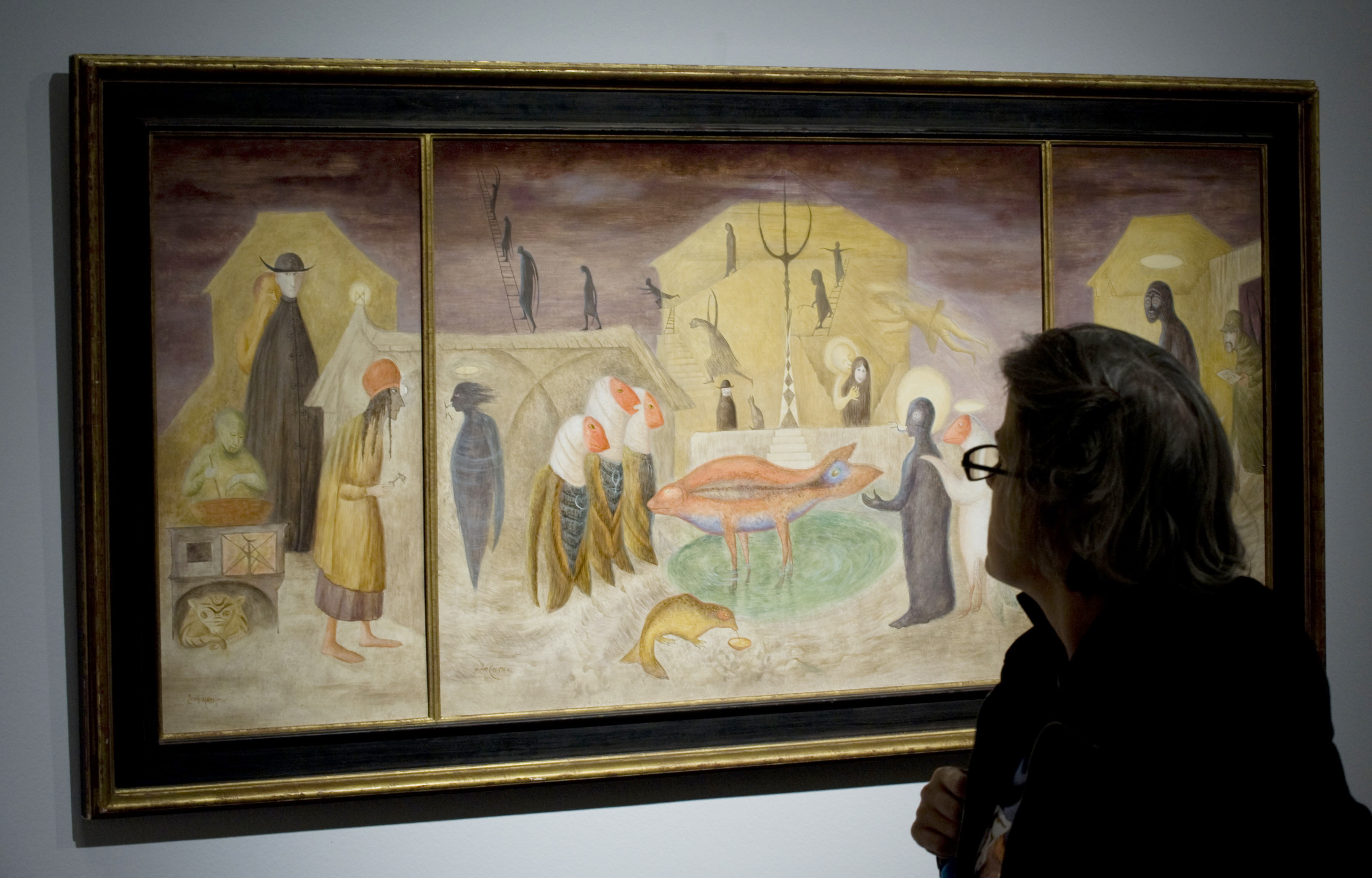 A journalist looks at Leonora Carrington's Nativity during Christie's press preview for Latin American Arts sale on November 13, 2009 in New York. (Getty)