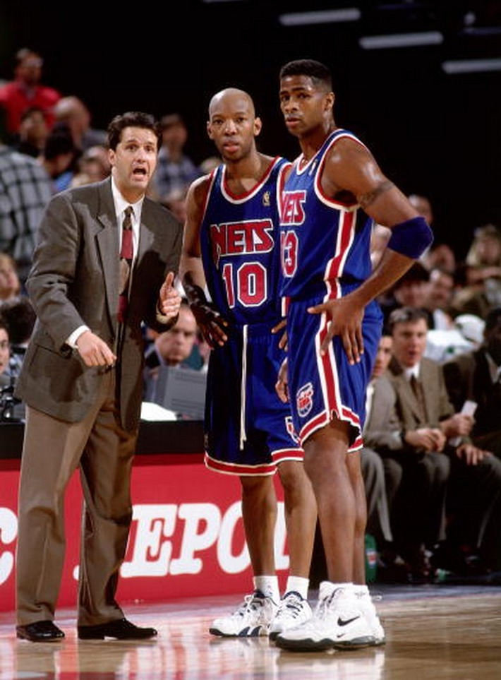 Sam Cassell and Kendall Gil talk with Nets Head Coach John Calipari. (Getty)