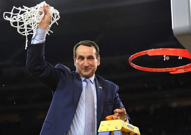 Duke's head coach Mike Krzyzewski waves to fans with the net after defeating Gonzaga in the Elite Eight of the 2015 NCAA Men's Basketball Tournament. (Getty)