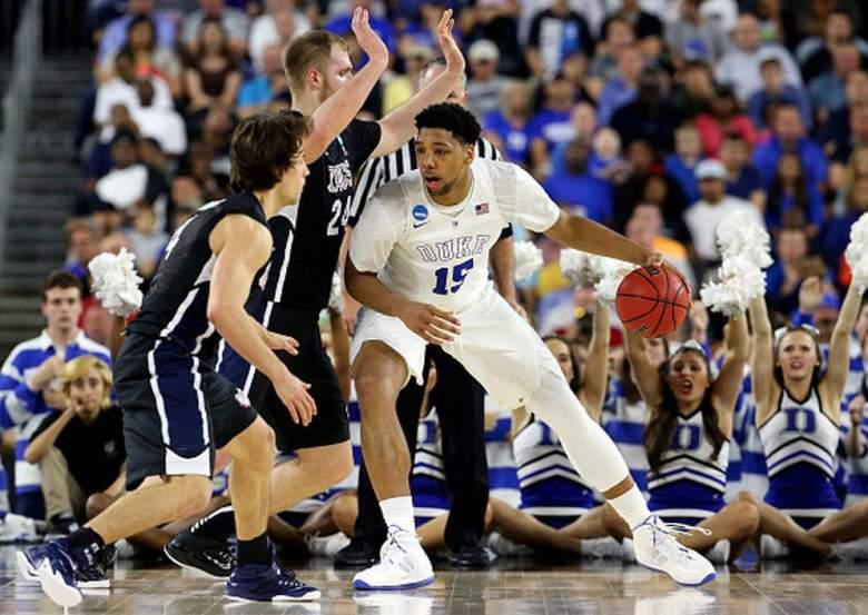 Duke's Jahlil Okafor drives to the basket against Gonzaga's Przemek Karnowski and Kevin Pangos during the 2015 NCAA Men's Basketball Tournament. (Getty)