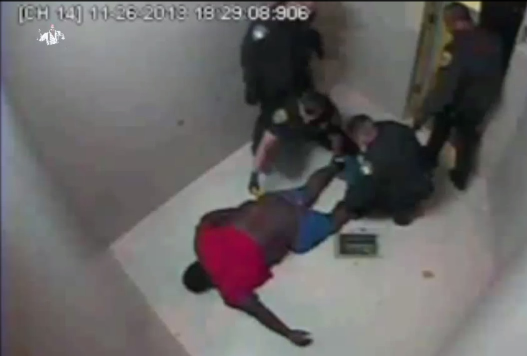 Officer Dustin McMullan is seen in jail cell surveillance video holding a Taser to Ervin Leon Edwards.