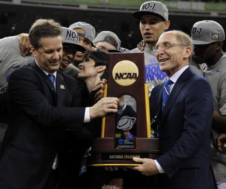 John and Ellen Calipari are joined by Kentucky president Eli Capilouto and the Wildcats team during the 2012 national championship trophy ceremony. (Getty)
