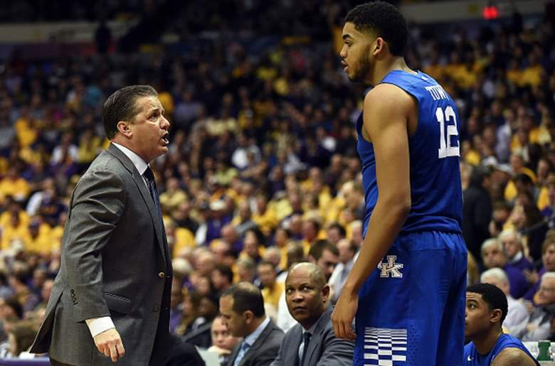 Kentucky head coach John Calipari speaks with Karl-Anthony Towns during a game against LSU. (Getty)