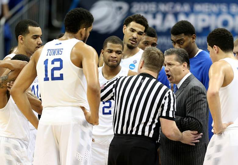 Kentucky head coach John Calipari talks to a referee after a technical foul is called on Aaron Harrison  during the 2015 NCAA Men's Basketball Tournament. (Getty)