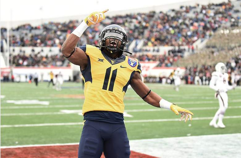 West Virginia wide receiver Kevin White celebrates. (Getty)