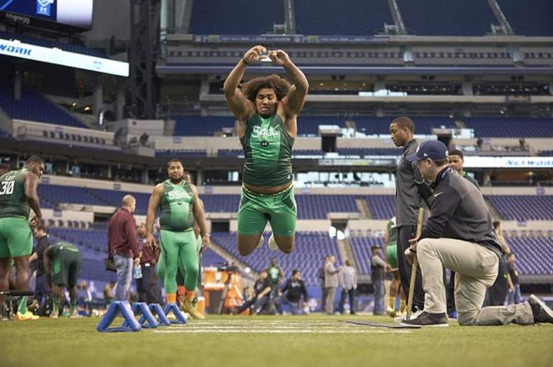 USC defensive end Leonard Williams does the long jump at the 2015 NFL combine. (Getty)