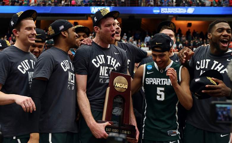 Michigan State Spartans team after winning the Elite Eight in the 2015 NCAA Tournament. (Getty)