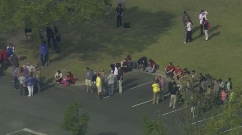 Evacuated students milling around the campus. (Screengrab via WRAL)