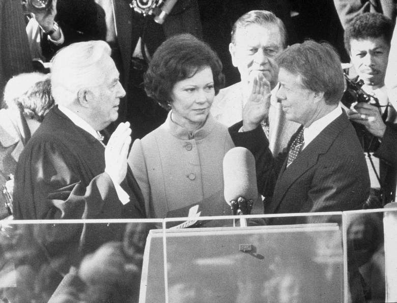 Democrat Jimmy Carter is sworn in by chief justice Earl Burger as the 39th president of the United States while first lady Rosalynn looks on. (Getty)
