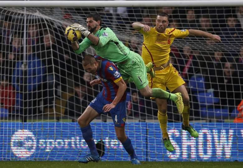Palace 'keeper Julian Sperroni beats Liverpool's Rickie Lambert to the ball (Getty)