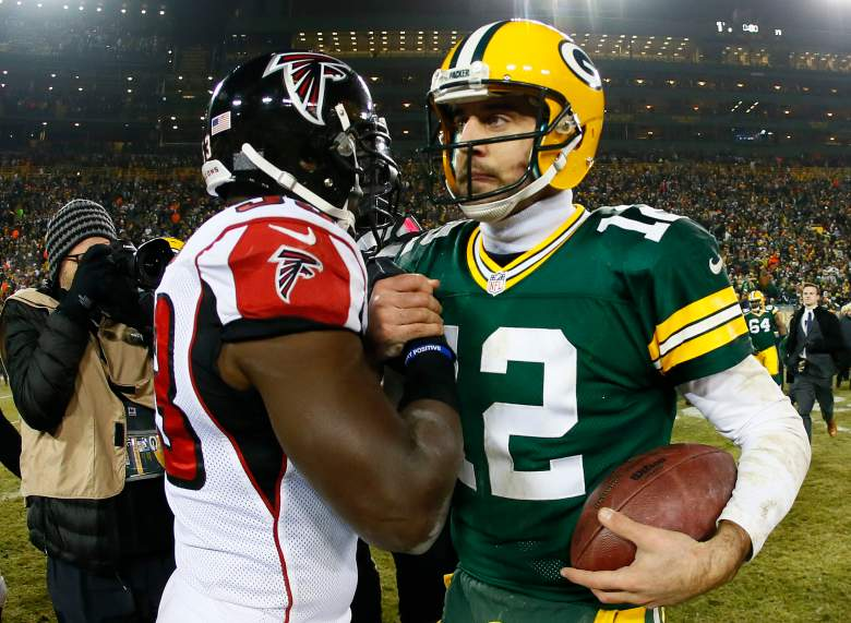 Shembo shakes hands with Green Bay Packers quarterback Aaron Rodgers after a game in 2014. (Getty)