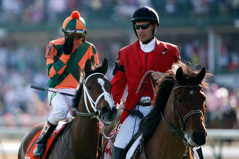 Jockey Kerwin D. Clark celebrates atop of Lovely Maria #7 on the way to Victory Circle after winning the 141st running of the Kentucky Oaks. (Getty)