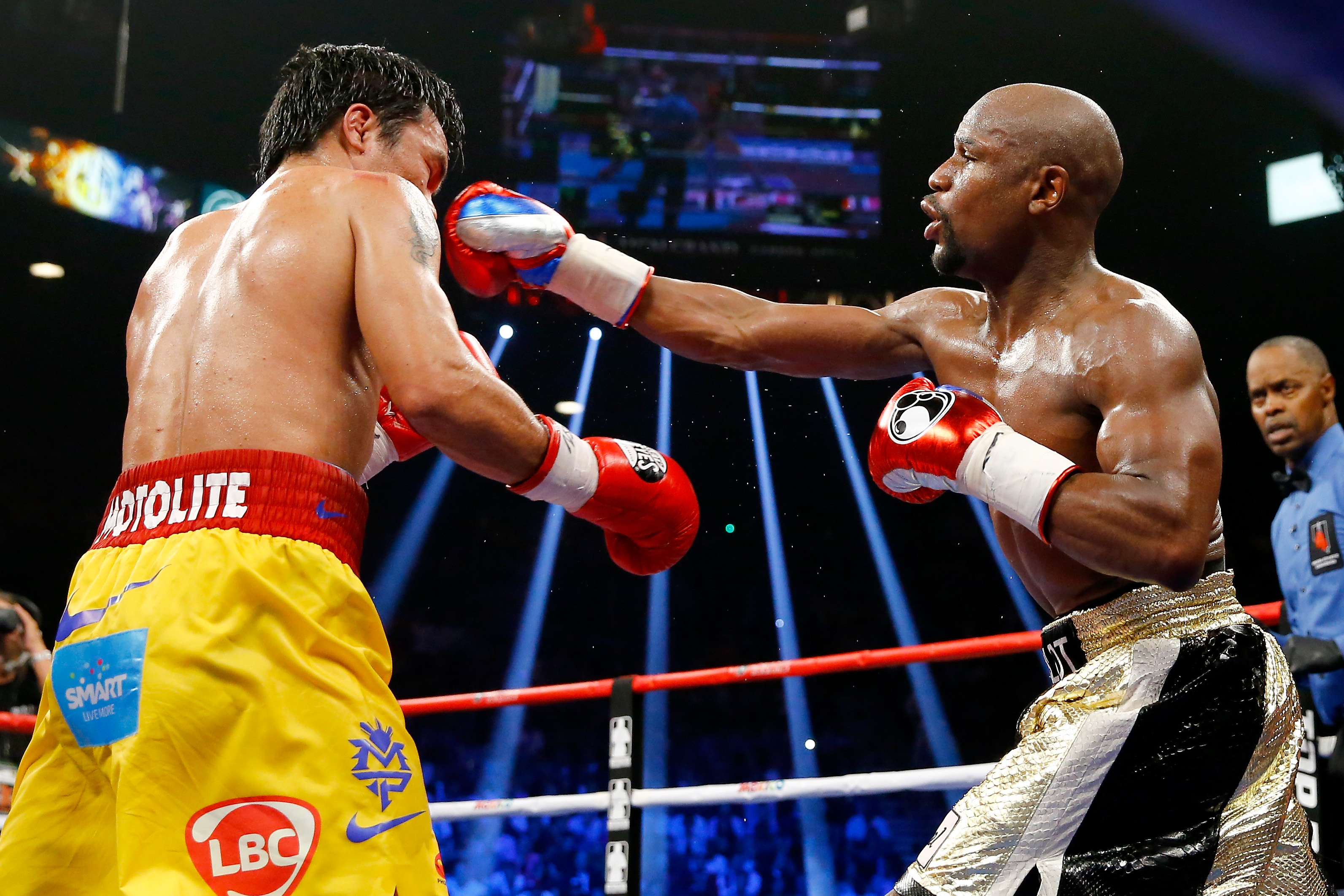 Floyd Mayweather Jr. throws a right at Manny Pacquiao during their welterweight unification championship bout on May 2, 2015 at MGM Grand Garden Arena in Las Vegas, Nevada. (Getty)