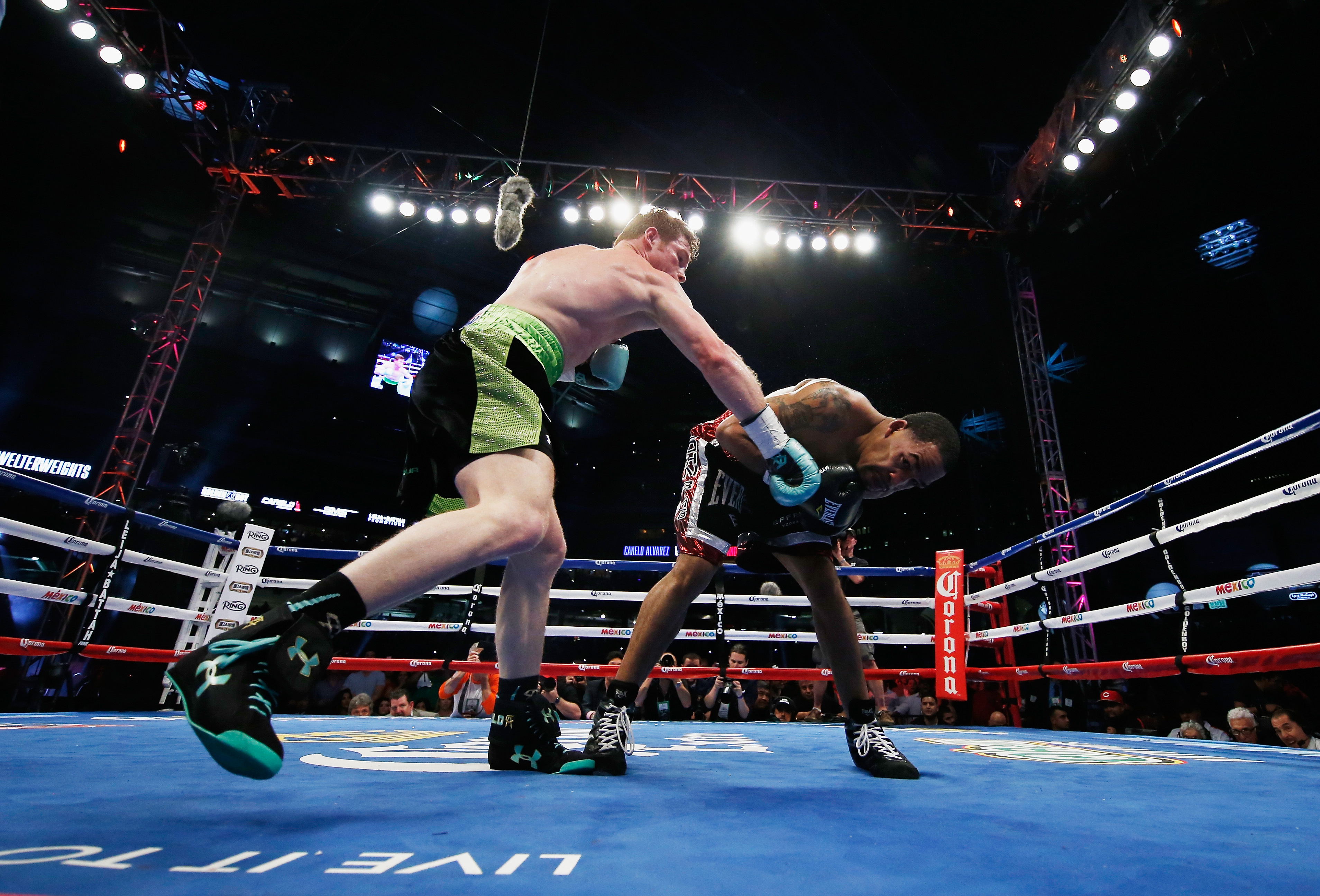 Canelo Alvarez delivers a right hand James Kirkland during their super welterweight bout at Minute Maid Park on May 9, 2015 in Houston, (Getty)