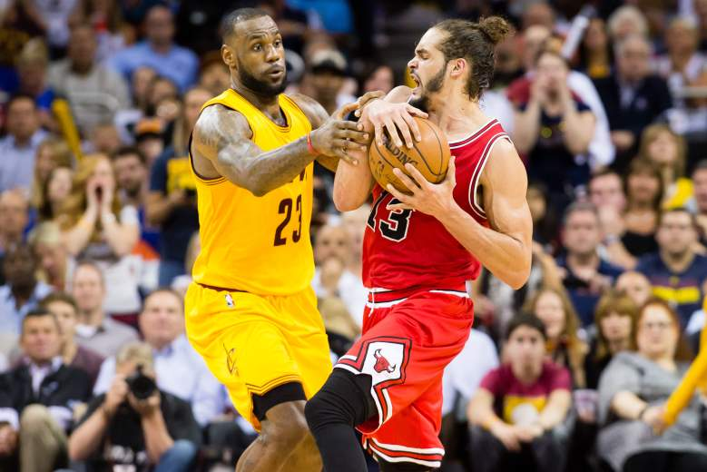 LeBron James of the Cavaliers, left, and the Bulls' Joakim Noah fight for possession in Game 5. (Getty)