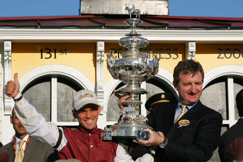 Bernardini jockey Javier Castellano (L) and a representative from Darley Stabes hoist the Woodlawn Vase in the winner's circle following the 131st Running of the Preakness Stakes on May 20, 2006 at Pimlico Raceway in Baltimore, Maryland.  (Photo by Jamie Squire/Getty Images)