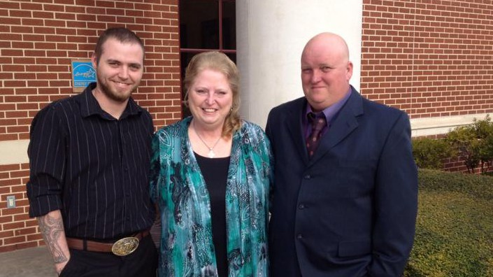 Daniel Boyett, right, with his wife and Cody Ledbetter, another member of the Cossacks.