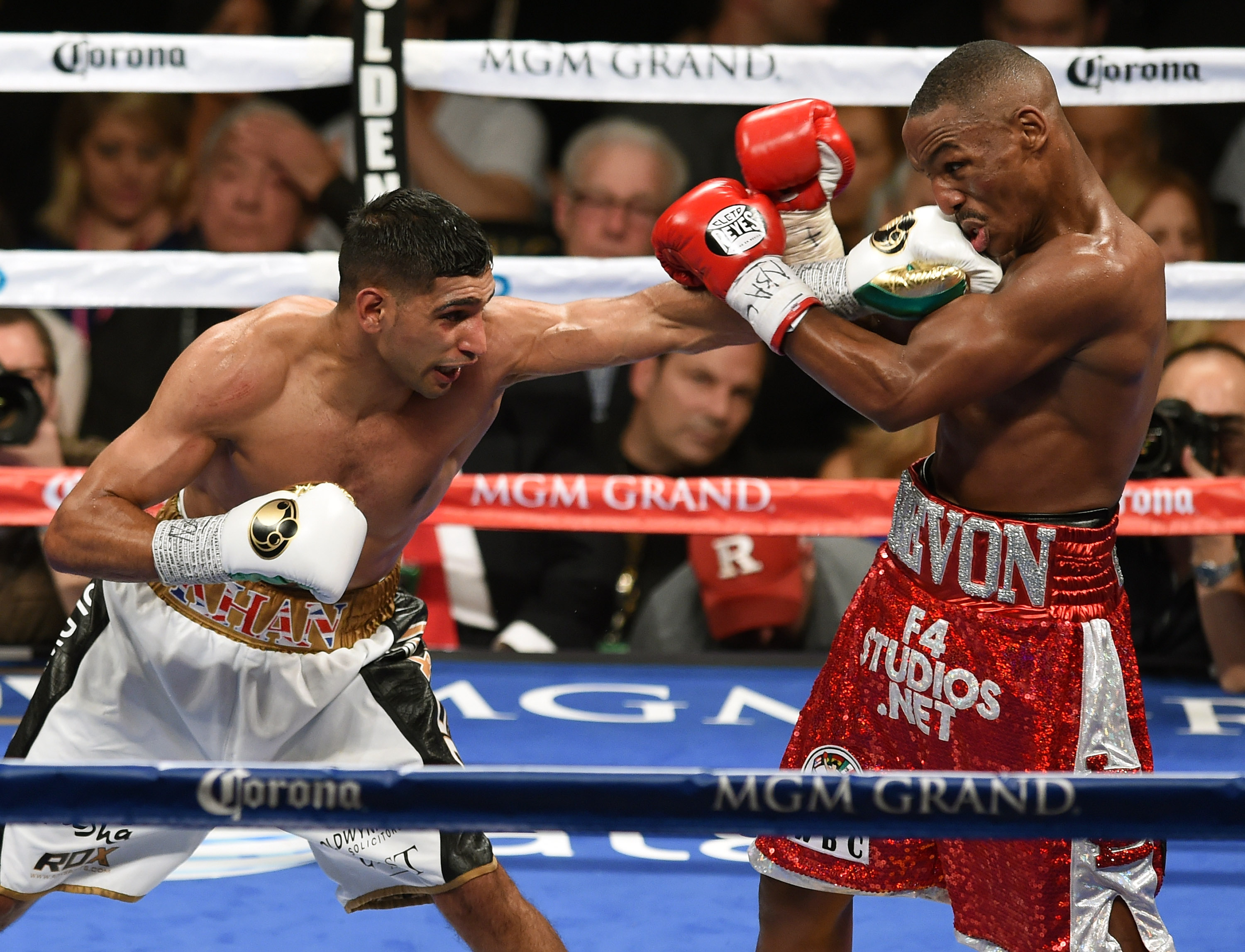 Amir Khan smashes Devon Alexander in the fifth round of their welterweight bout at the MGM Grand Garden Arena on December 13, 2014. (Getty)