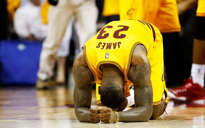 LeBron James crumbles to the floor after Cleveland's win over Atlanta in Game 3 on Sunday. (Getty)