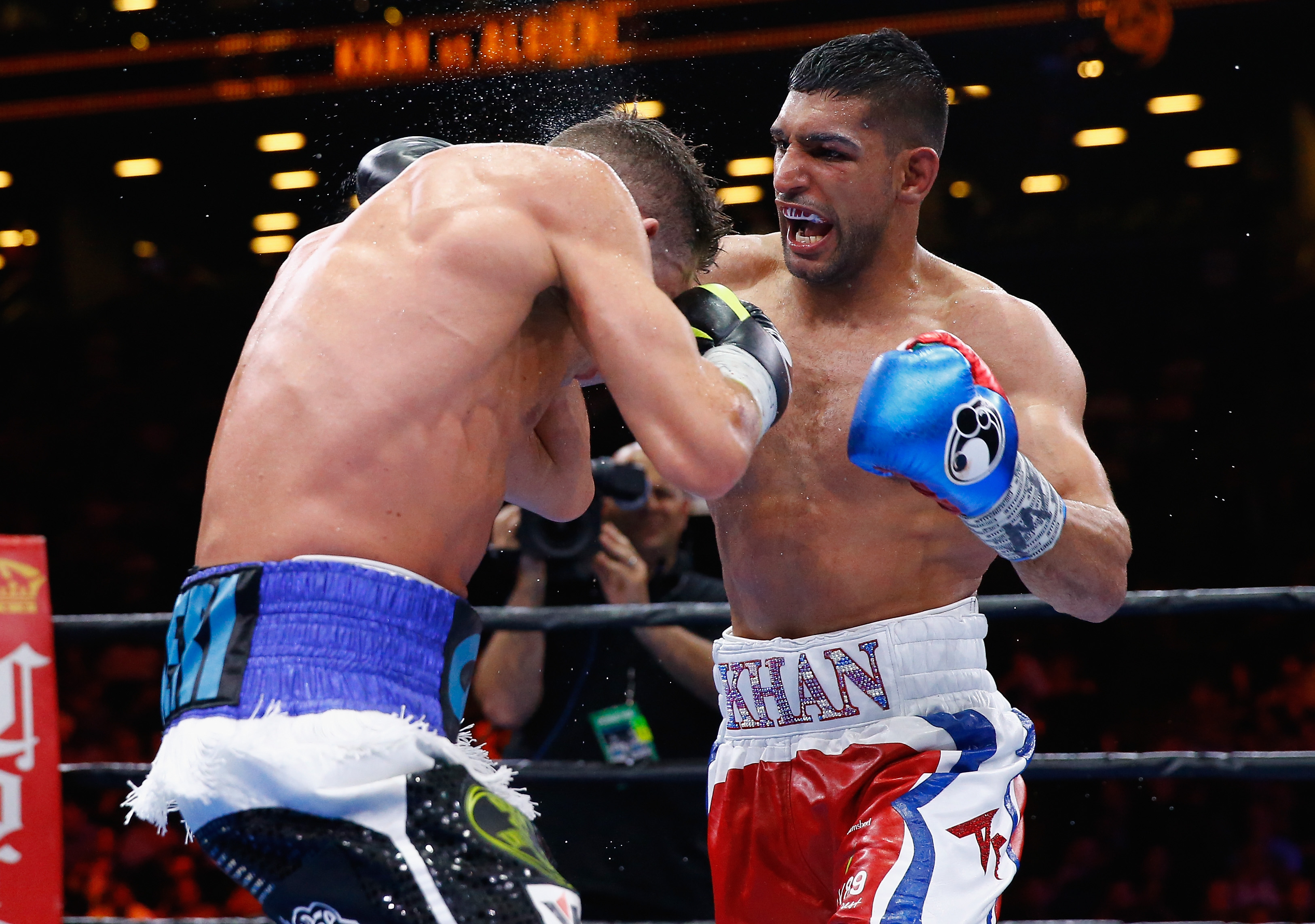 Amir Khan punches Chris Algieri during their Welterweight bout at Barclays Center of Brooklyn on May 29, 2015 in New York City. (Getty)