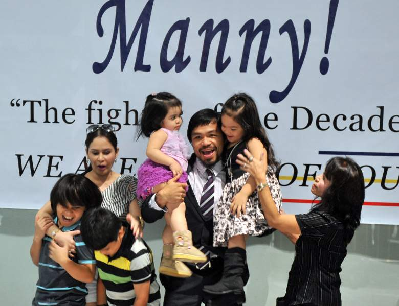 Manny Pacquiao, pictured with daughters Queen Elizabeth (top L), and Princess (top R), is very generous with his wealth. (Getty)
