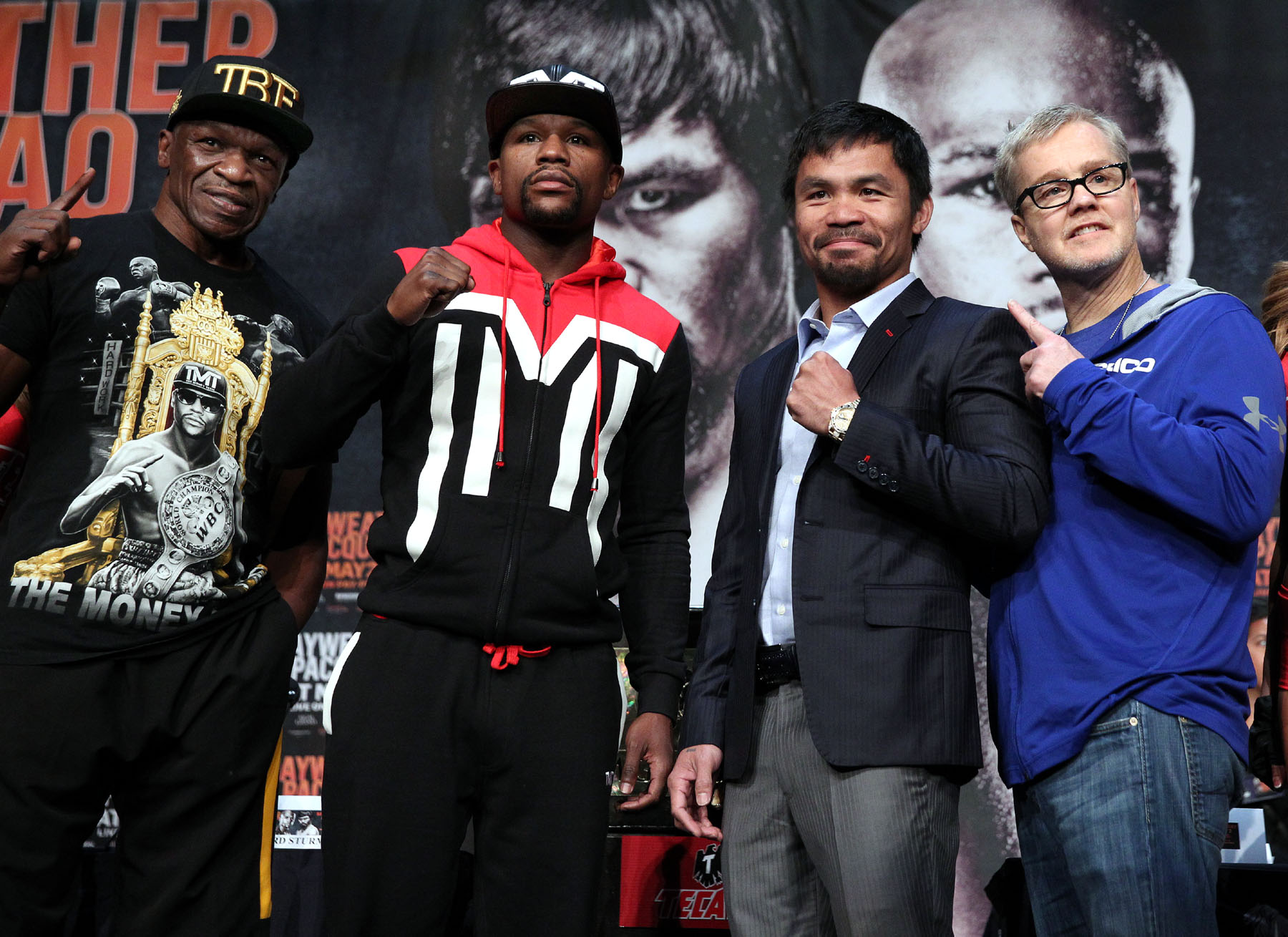 Manny Pacquiao and trainer Freddie Roach and  and Floyd Mayweather and dad Floyd Sr. attend the final press conference Wednesday for their upcoming historic 12-round welterweight world championship unification mega-fight.           ---   Photo Credit : Chris Farina - Top Rank