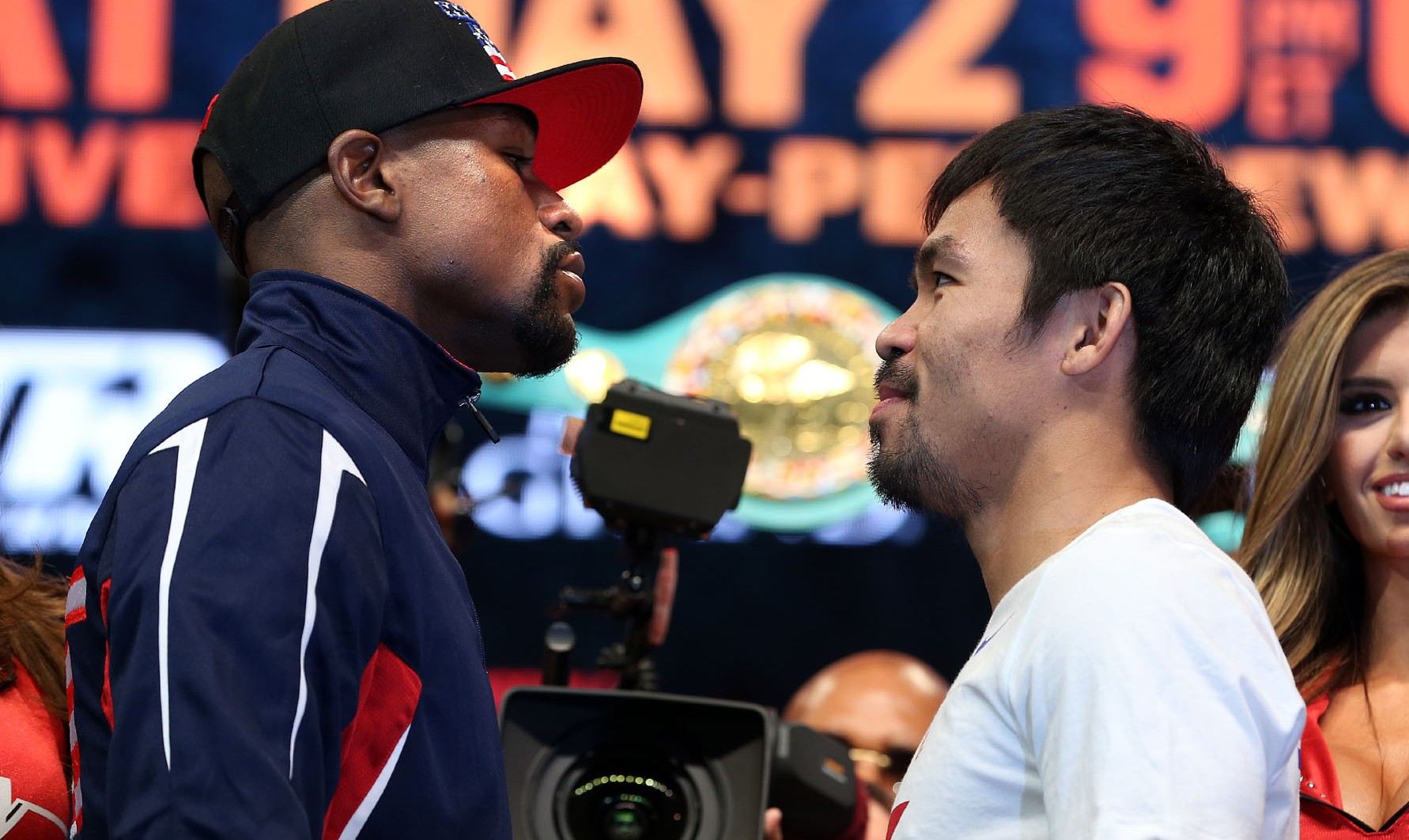 Superstar Manny Pacquiao and  and Floyd Mayweather weigh in (145   146)  for their upcoming historic 12-round welterweight world championship unification mega-fight.   Photo Credit : Chris Farina - Top Rank