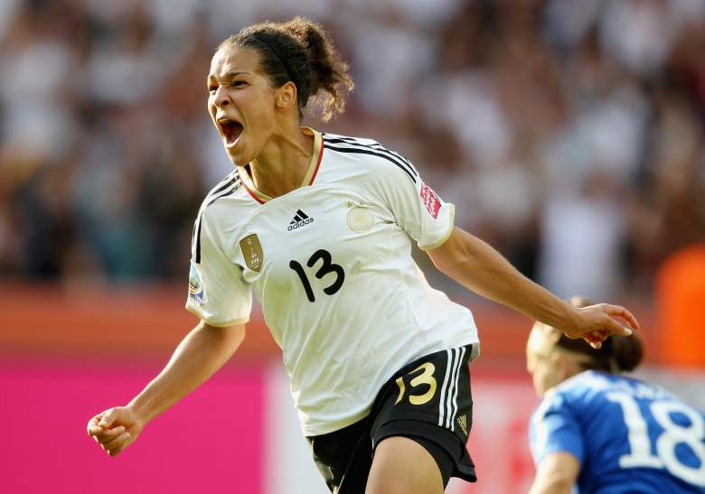 BERLIN, GERMANY - JUNE 26:  Celia Okoyino Da Mbabi of Germanycelebrates after scoring their second goal during the FIFA Women's World Cup Group A match between Germany and Canada at Olympic Stadium on June 26, 2011 in Berlin, Germany.  (Photo by Scott Heavey/Getty Images)