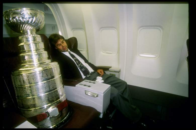 15 Aug 1997:  Manager Phil Pritchard of the hockey Hall of Fame relaxes with the Stanley Cup next to him on the Detroit Red Wings trip to Russia at JFK Airport in New York City, New York. Mandatory Credit: Ezra O. Shaw  /Allsport