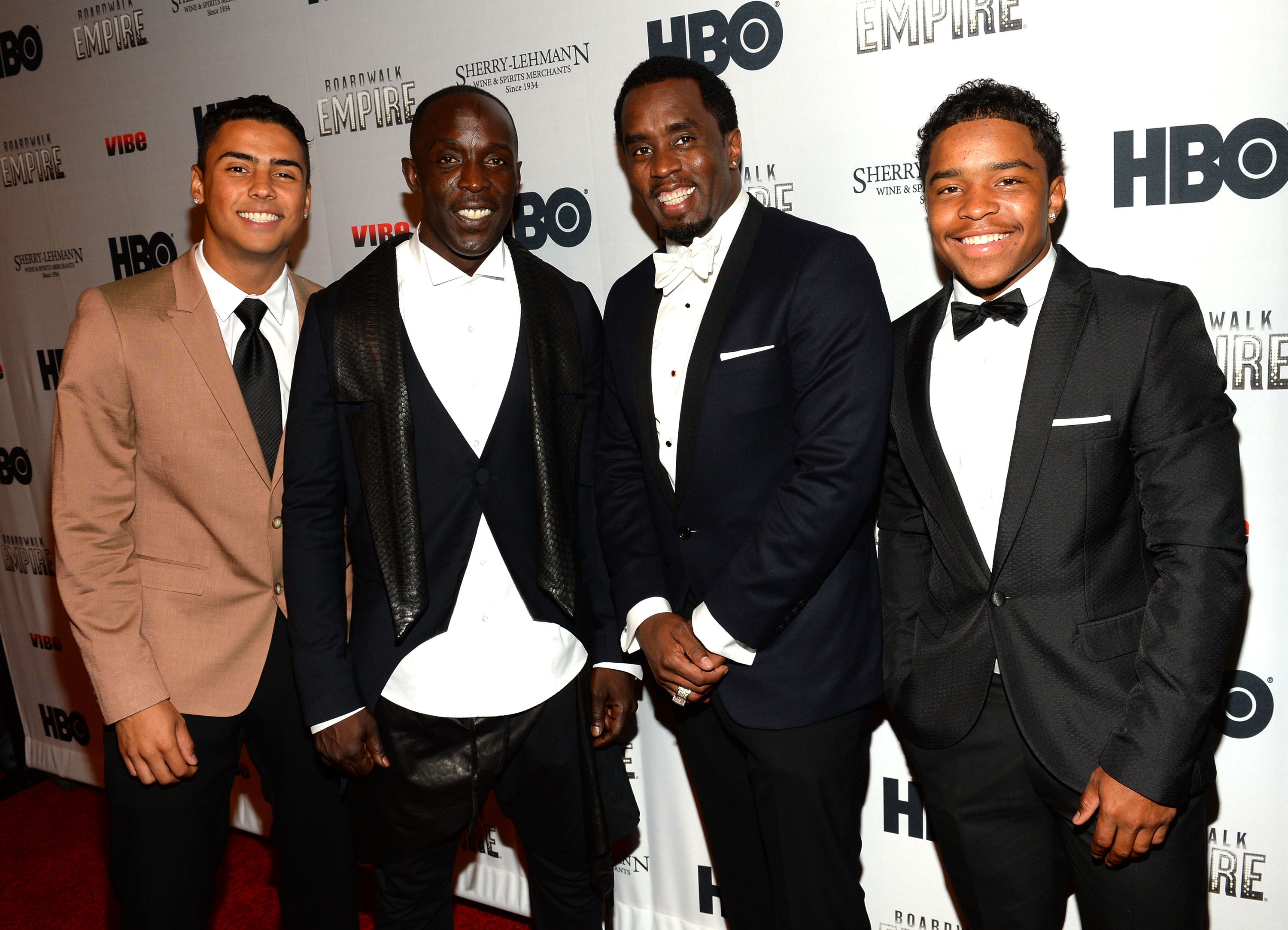 Diddy with actor Michael Williams and two of his sons, including Justin Combs, left.