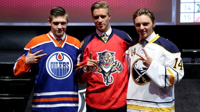 Leon Draisaitl, third overall pick by the Edmonton Oilers, Aaron Ekblad, first overall pick by the Florida Panthers, and Sam Reinhart, second overall pick by the Buffalo Sabres pose during the first round of the 2014 NHL Draft at the Wells Fargo Center on June 27, 2014 in Philadelphia, Pennsylvania.  (Getty)