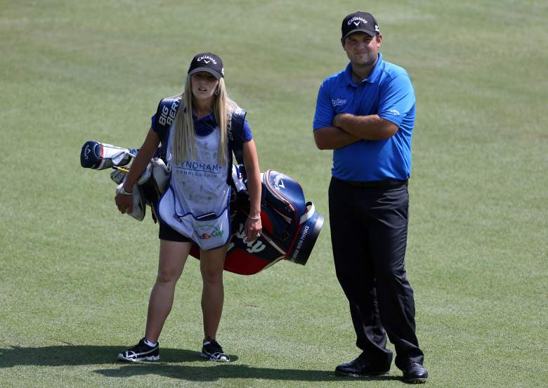 GREENSBORO, NC - AUGUST 16:  (R-L) Patrick Reed stands in the fairway with wife and caddie Justine Reed before playing a shot on the 11th hole during the third round of the Wyndham Championship at Sedgefield Country Club on August 16, 2014 in Greensboro, North Carolina.  (Photo by Todd Warshaw/Getty Images)