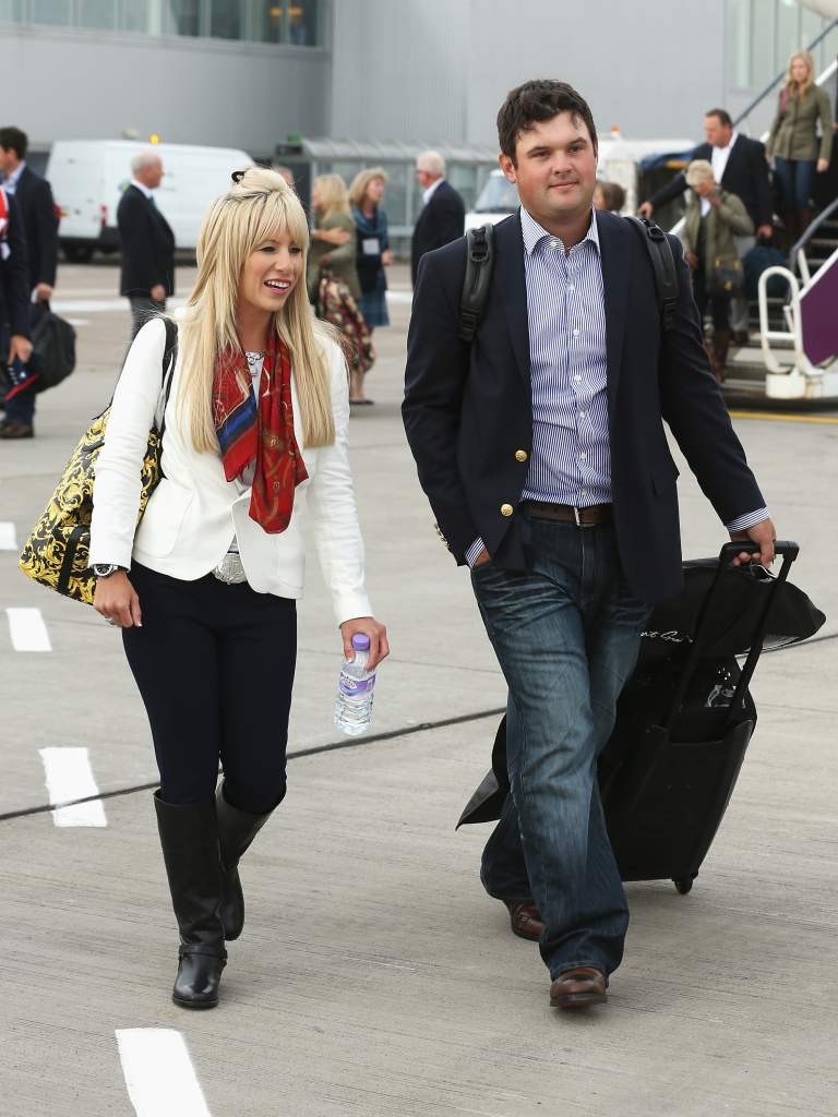 EDINBURGH, SCOTLAND - SEPTEMBER 22:  Patrick Reed of the United States and wife Justine Reed arrive at Edinburgh Airport ahead of the 2014 Ryder Cup at Gleneagles on September 22, 2014 in Edinburgh, Scotland.  (Photo by Ross Kinnaird/Getty Images)