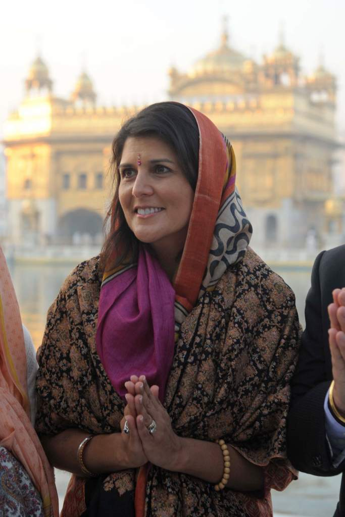 Governor of the US State of South Carolina Nikki Haley poses at the Golden Temple in Amritsar on November 15, 2014. Haley  visited  the city to pay her respects at the Golden Temple and Jallianwala Bagh. Haley is in India to take forward her initiative to sell South Carolina as a profitable investment destination. Nikki Haley, whose parents immigrated to the US in 1960s, has recently been elected the governor of the US state.  AFP PHOTO/NARINDER NANU        (Photo credit should read NARINDER NANU/AFP/Getty Images)