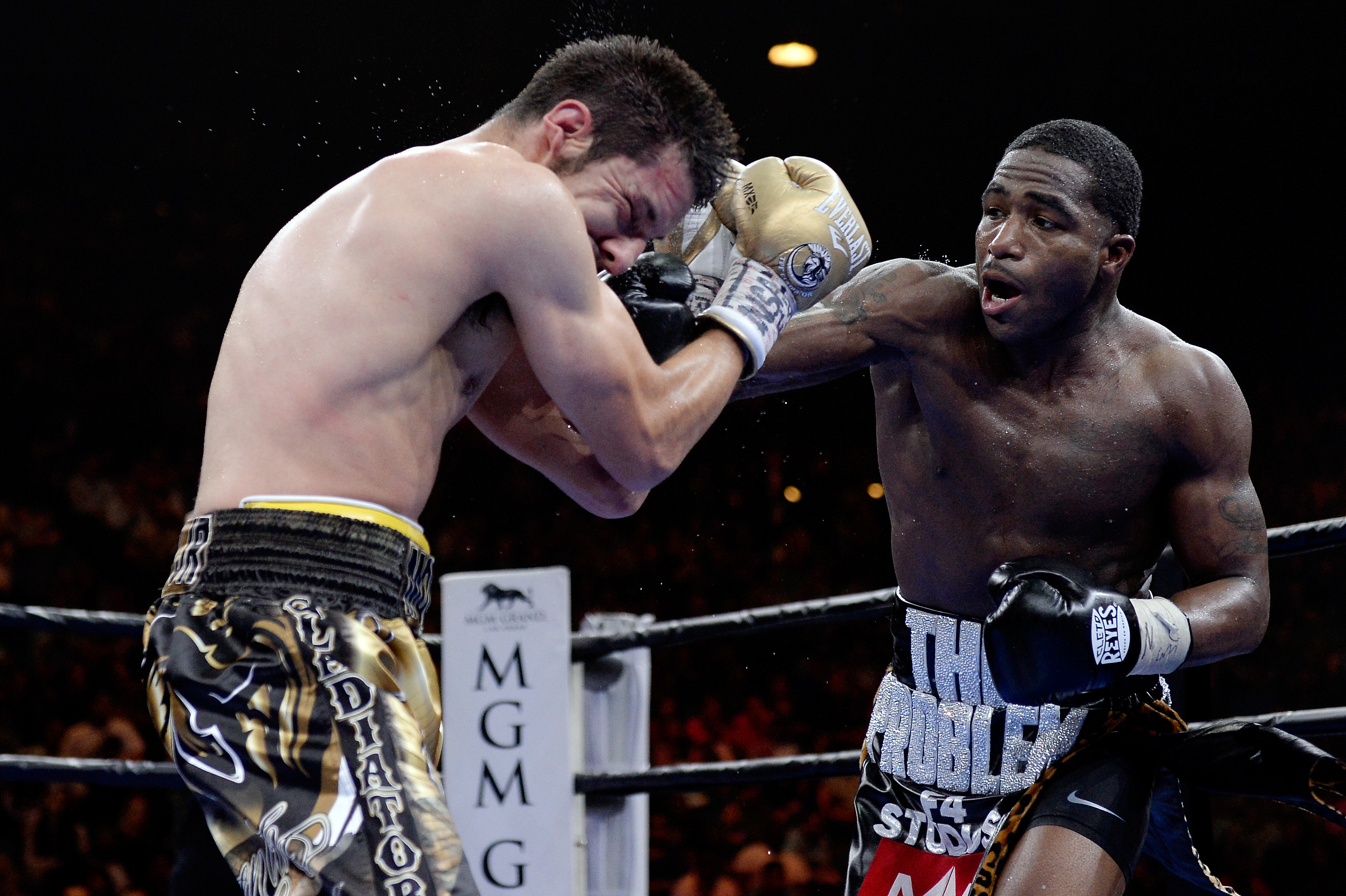 LAS VEGAS, NV - MARCH 07:  Adrien Broner punches John Molina Jr. during a Premier Boxing Champions bout in the MGM Grand Garden Arena on March 7, 2015 in Las Vegas, Nevada.  (Photo by Harry How/Getty Images)