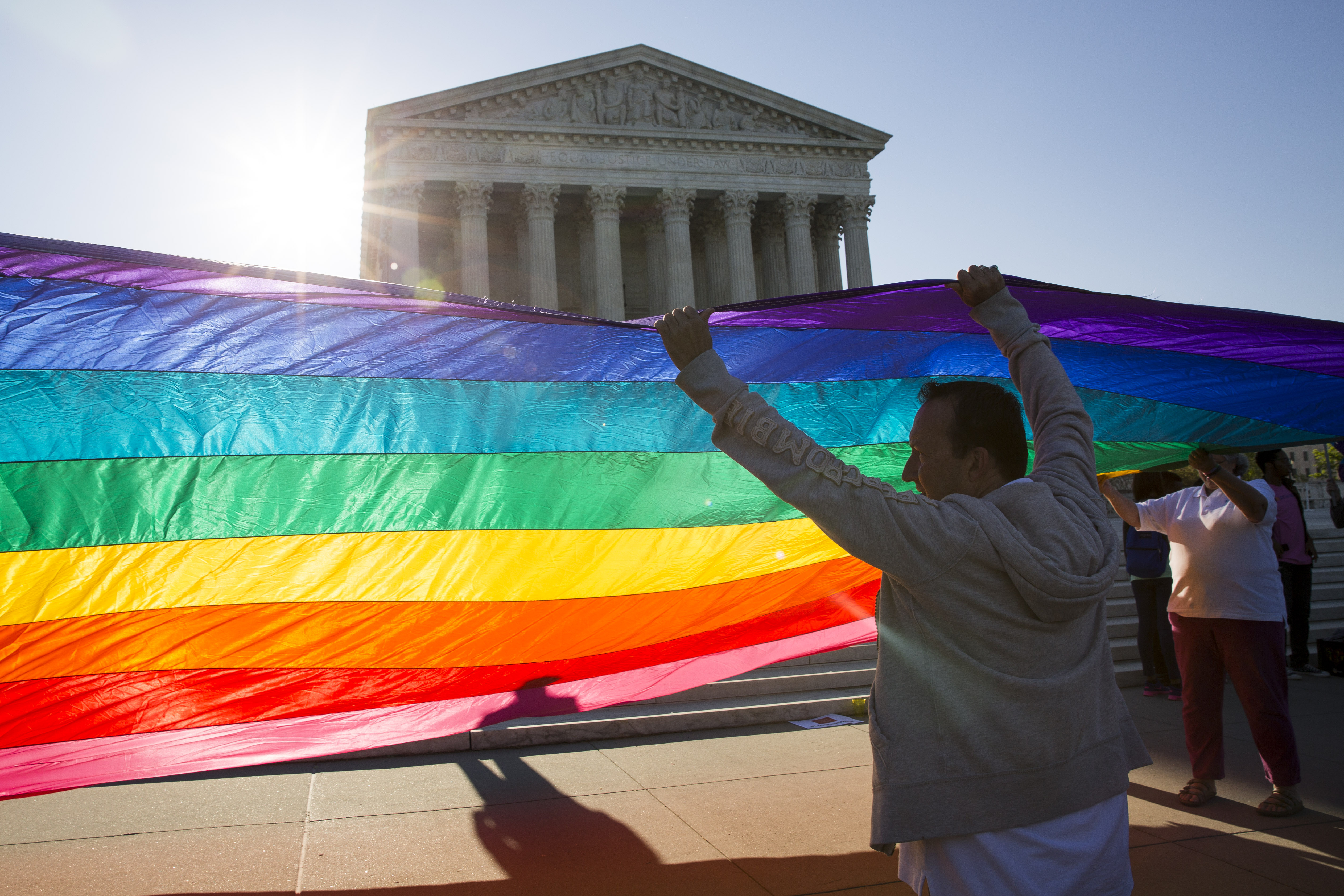 Supporters of same-sex marriage unfurl a large rainbow pride flag near the Supreme Court, April 28, 2015 in Washington, DC. (Getty)