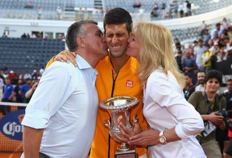 ROME, ITALY - MAY 17:  Novak Djokovic of Serbia celebrates with the Winner's Trophy and his parents after his victory over Roger Federer of Switzerland in the Men's Singles Final on Day Eight of The Internazionali BNL d'Italia 2015 at the Foro Italico on May 17, 2015 in Rome, Italy.  (Photo by Ian Walton/Getty Images)