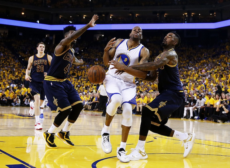 Andre Iguodala drives against J.R. Smith in the first half during Game One of the 2015 NBA Finals.  (Photo by Ezra Shaw/Getty Images)