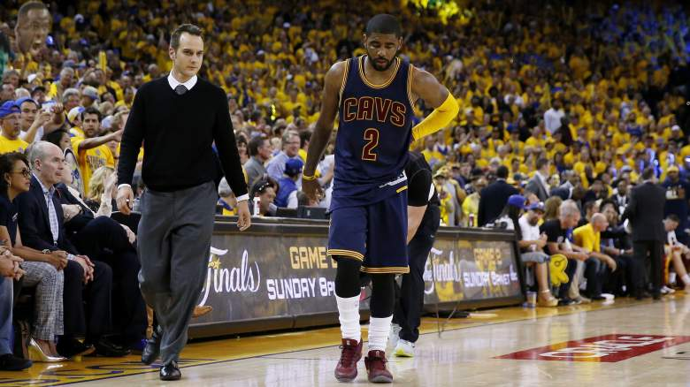 Kyrie Irving limps off the court after suffering a fractured knee cap during Game 1 of the 2015 NBA Finals. (Getty)