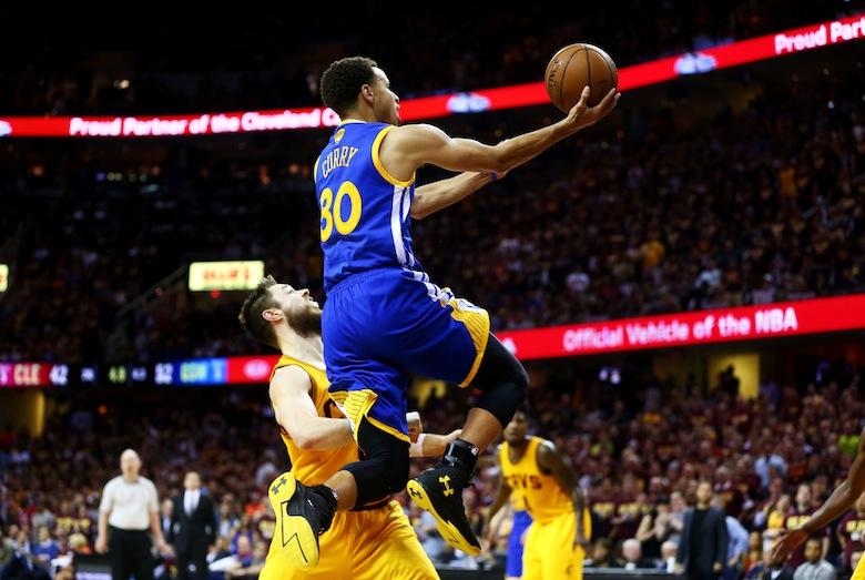 CLEVELAND, OH - JUNE 11:  Stephen Curry #30 of the Golden State Warriors goes up against Matthew Dellavedova #8 of the Cleveland Cavaliers in the second quarter during Game Four of the 2015 NBA Finals at Quicken Loans Arena on June 11, 2015 in Cleveland, Ohio.  NOTE TO USER: User expressly acknowledges and agrees that, by downloading and or using this photograph, user is consenting to the terms and conditions of Getty Images License Agreement.  (Photo by Ronald Martinez/Getty Images)