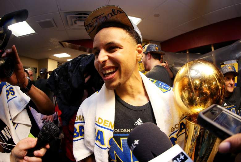 Steph Curry celebrates in the locker room. (Getty)