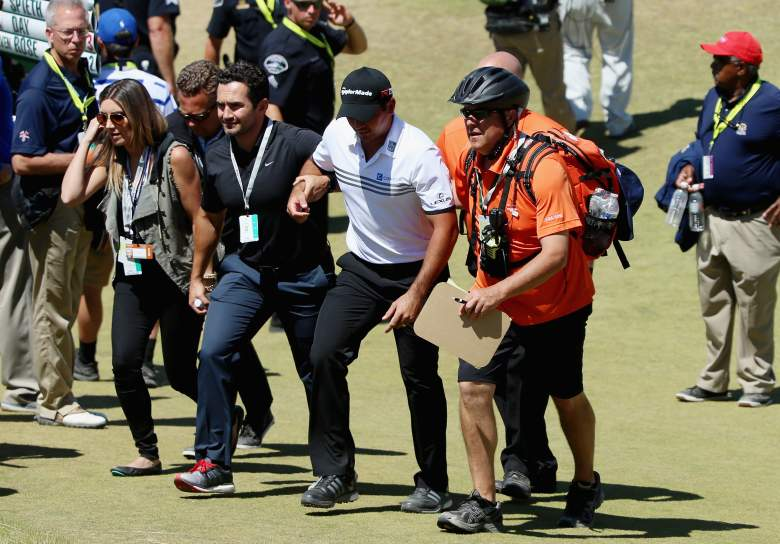UNIVERSITY PLACE, WA - JUNE 19:  Jason Day of Australia is tended to by medical staff after finishing the ninth hole during the second round of the 115th U.S. Open Championship at Chambers Bay on June 19, 2015 in University Place, Washington.  (Photo by Andrew Redington/Getty Images)