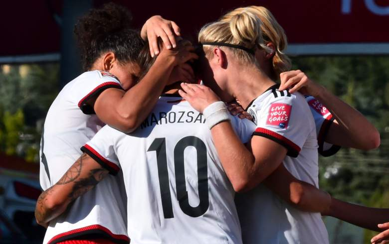 Germany's Dzsenifer Marozsan (C) celebrates with team mates after scoring a goal during their 2015 FIFA Women's World Cup football round of 16 match between Sweden and Germany at Lansdowne Stadium in Ottawa, Ontario on June 20, 2015.    AFP PHOTO/NICHOLAS KAMM        (Photo credit should read NICHOLAS KAMM/AFP/Getty Images)