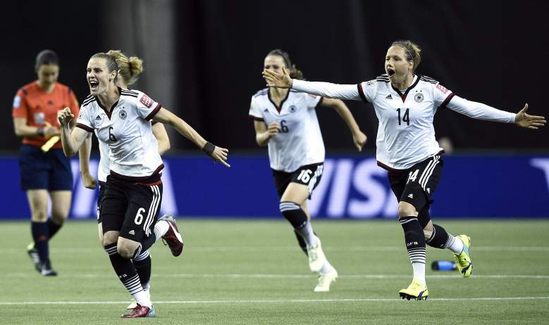 (L-R) Germany's midfielder Simone Laudehr, Germany's midfielder Melanie Leupolz and defender Babett Peter react after winning the quarter-final football match between Germany and France in the 2015 FIFA Women's World Cup at the Olympic Stadium in Montreal on June 26, 2015. AFP PHOTO/FRANCK FIFE         (Photo credit should read FRANCK FIFE/AFP/Getty Images)